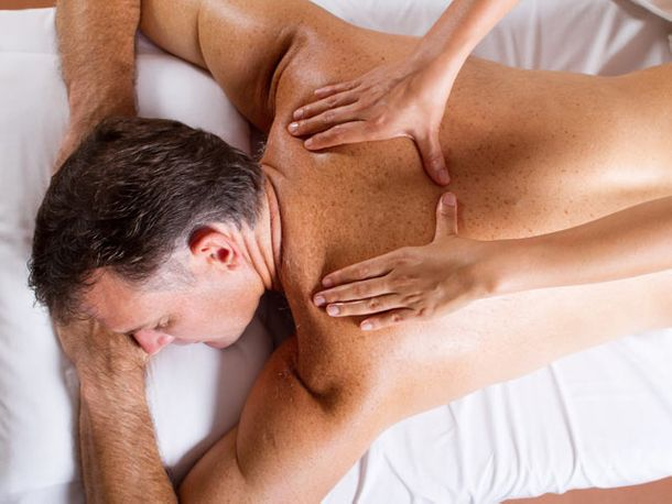 Men receiving upper back massage